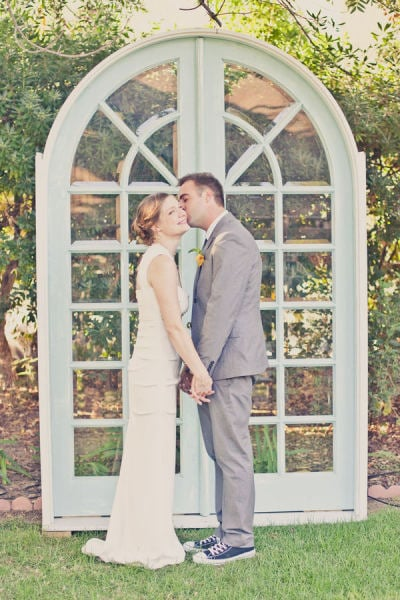 A pair of standing doors perfectly sets the ceremony scene, and the type of doors can make a major statement. Arched glass doors say something very different than antique wooden doors, for instance, so get creative with your options. Photo by One Love Photography via Style Me Pretty