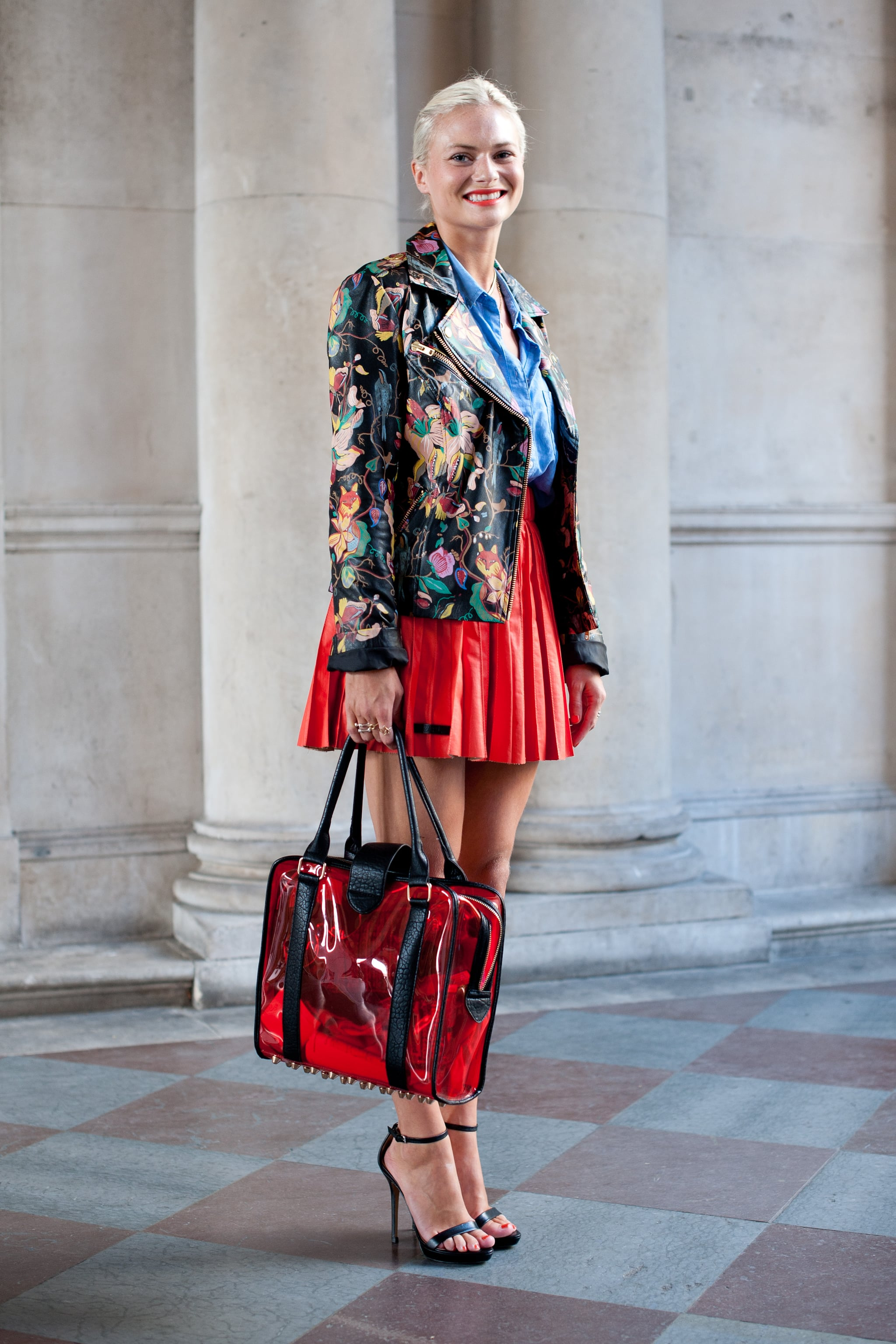Red statement pieces go a long way, as proven by Daily Mail deputy editor Pandora Sykes. Her siren-hued pleated skirt and PVC-infused bag made quite the fiery street-style impression.