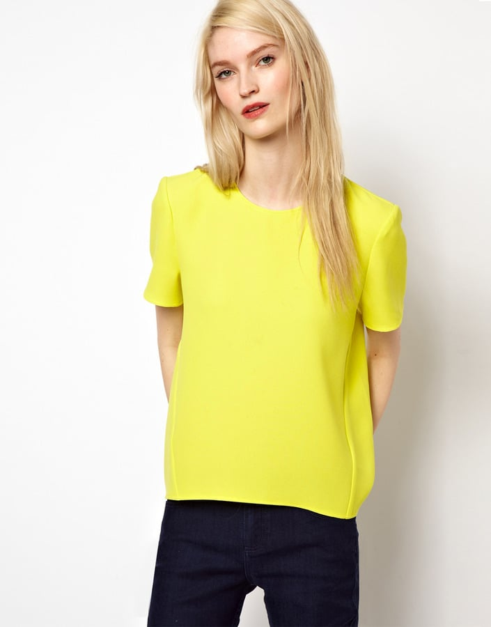 Between the sculpted shoulders and bold citron hue, this Whistles t-shirt ($125) makes the perfect go-anywhere statement piece.
