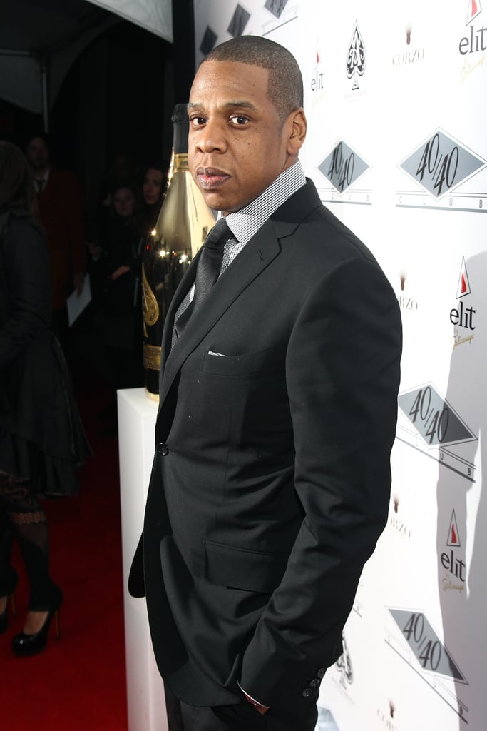 Jay-Z made his first red carpet appearance after the birth of his daughter, Blue Ivy, to re-open his 40/40 Club in NYC on Jan. 18.