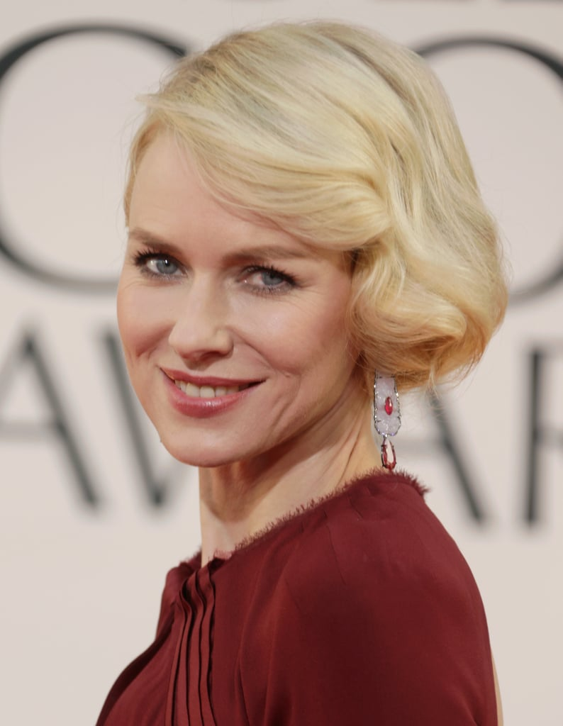 An S-curl in the front of Naomi Watts' faux bob gave a vintage feel. Part the hair far to one side, and set the top layers on medium-size heated rollers to get this look.