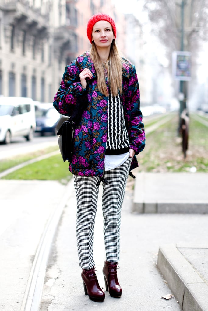 Florals, stripes, checks, and splashes of bright color all came together in easy proportions on this attendee's punk-meets-prep ensemble.
