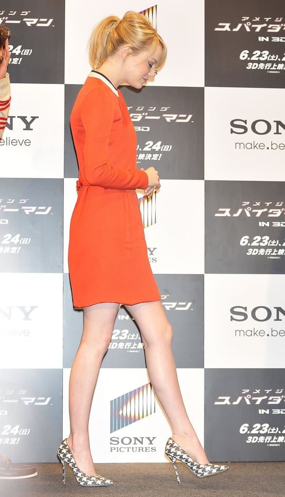 Emma Stone wore a bright orange dress for the press conference for The Amazing Spider-Man in Japan.