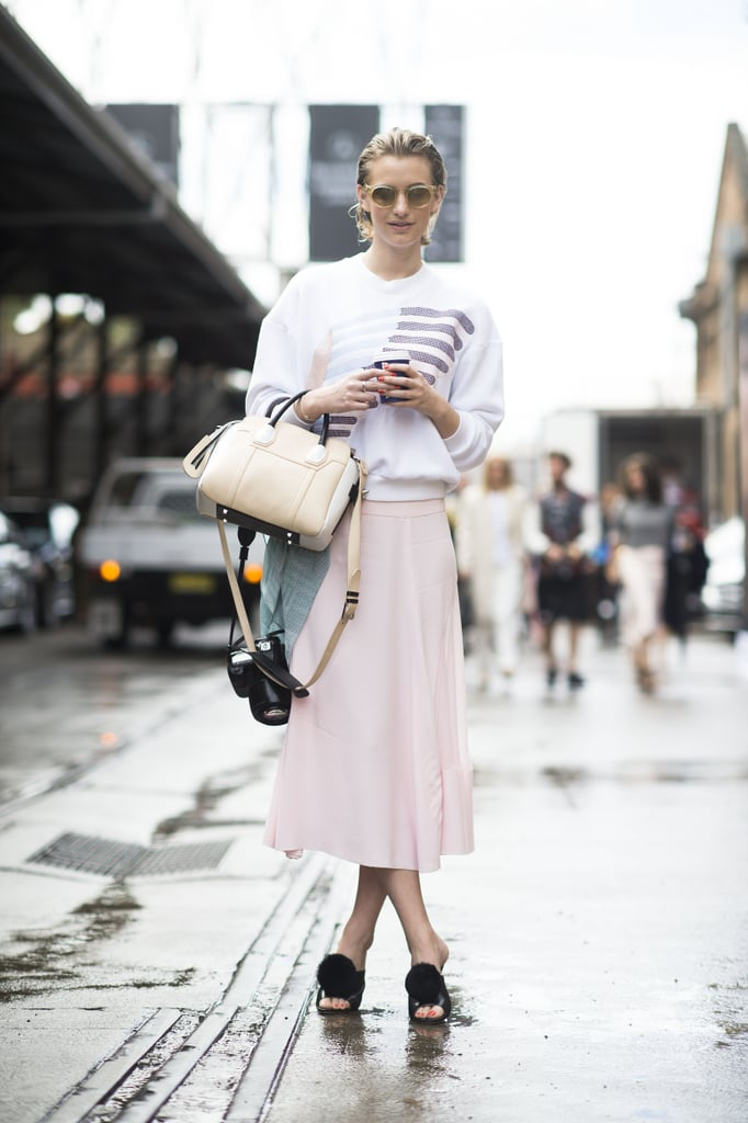 With pompoms, these mules feel just a bit boudoir-inspired, but this style setter balances out the playful vibe with a tomboy sweatshirt and soft petal-pink skirt.   Source: Gorunway.com/Matteo Catena