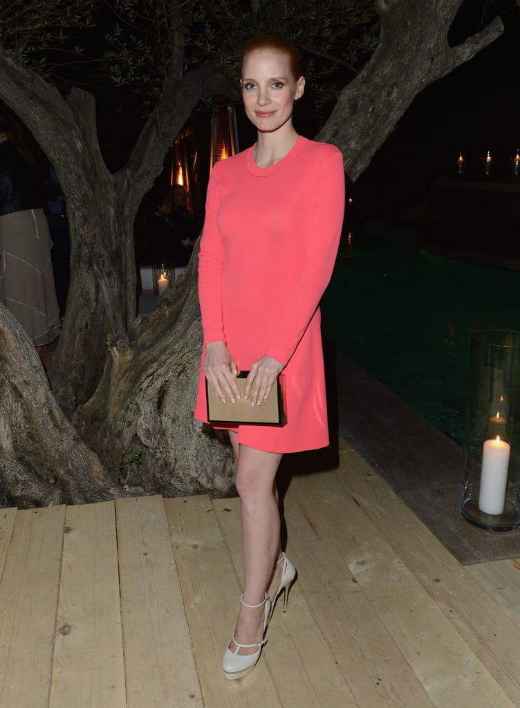 Jessica Chastain opted for a long-sleeved Calvin Klein coral minidress with a tan clutch and nude Elie Saab heels for the Women in Film party.