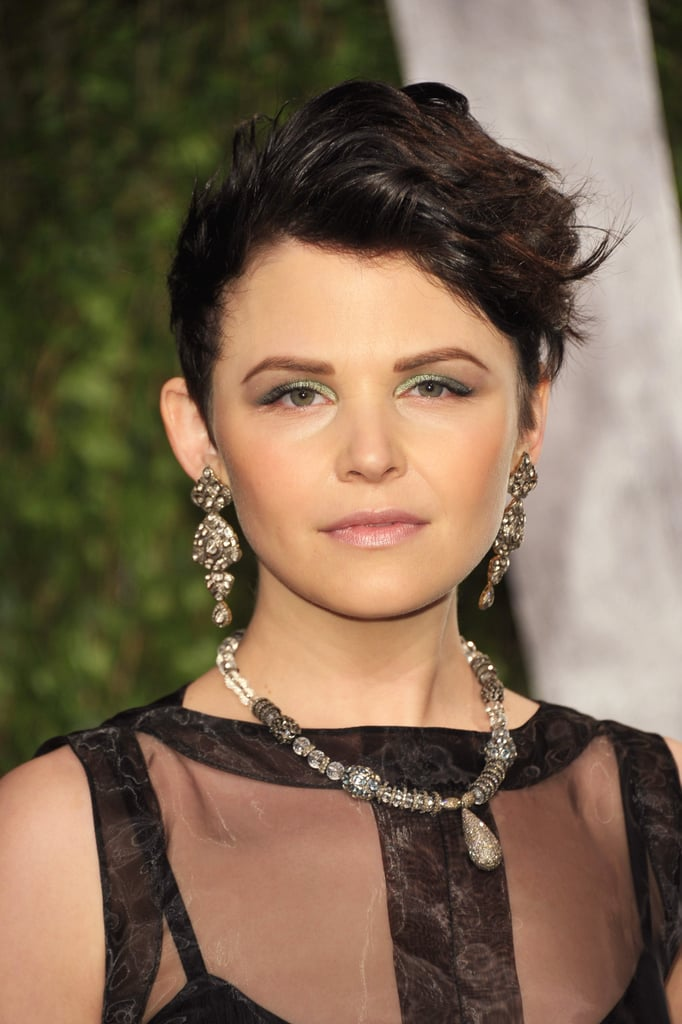 For a more edgy look, Ginnifer slicked back her sides and went for an asymmetric coif that was topped with tousled waves.