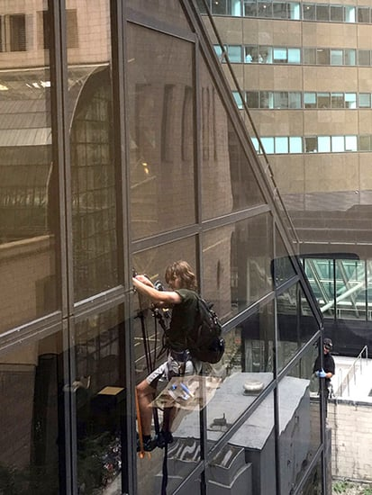 A Man Is Scaling the Side of Trump Tower Using Suction Cups