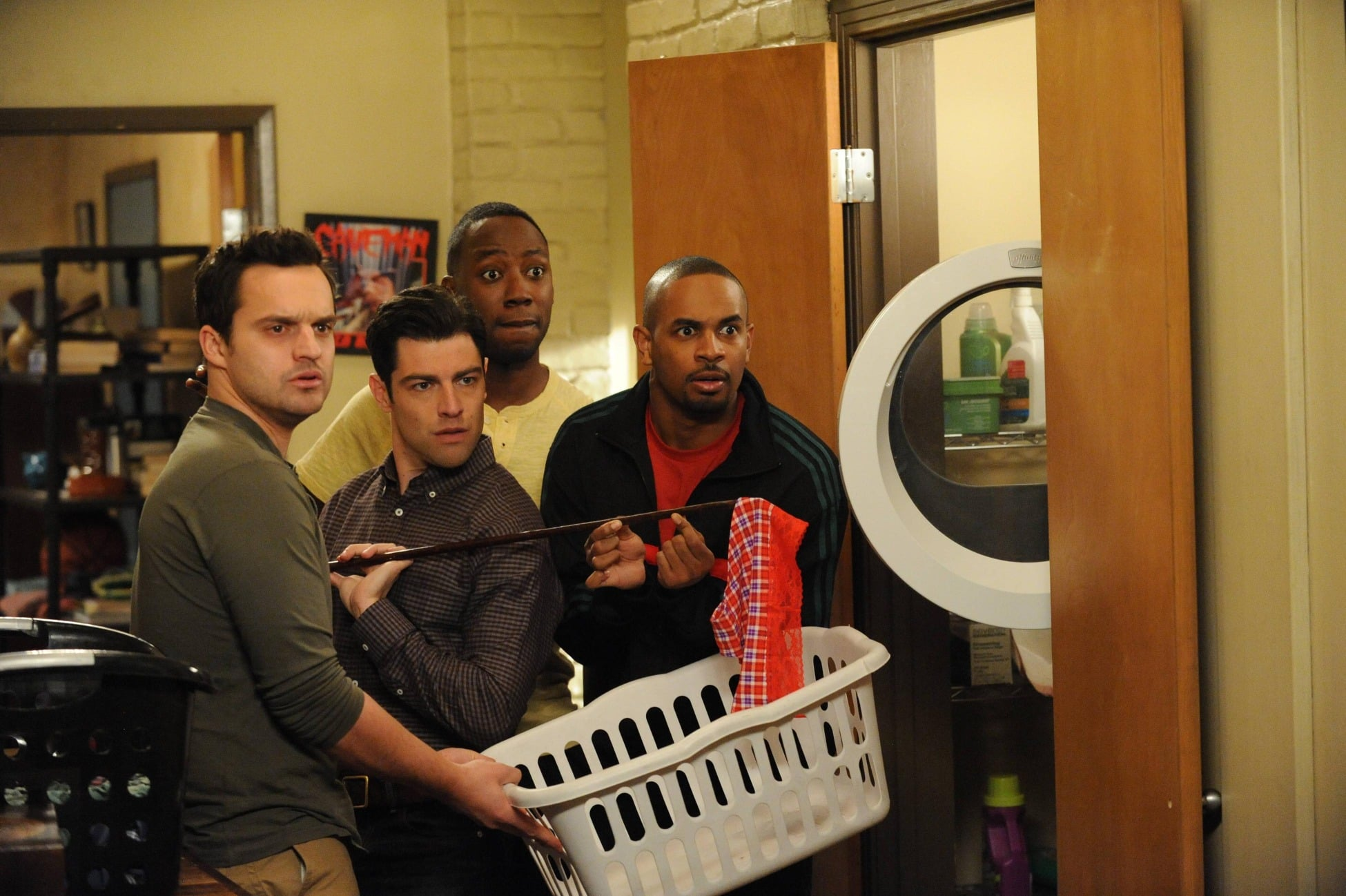 Nick, Schmidt (Max Greenfield), Winston (Lamorne Morris), and Coach (Damon Wayans Jr.) get caught in a suspicious moment.