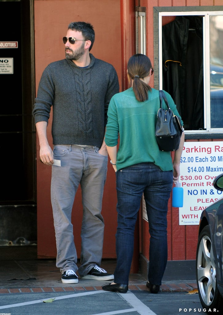 Jennifer Garner was dressed in a green sweater and sunglasses while out running errands with husband Ben Affleck in LA.