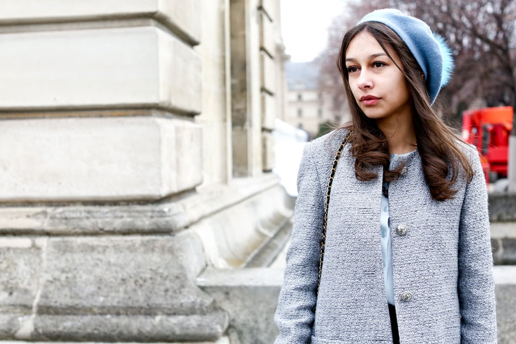 A cool cap makes everything all the more fashionable, as evidenced by this young woman.