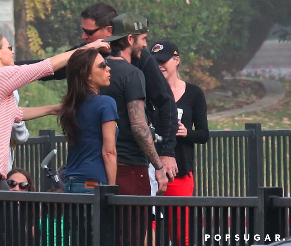 David Beckham and Victoria Beckham stood on the sidelines while little Harper played soccer.