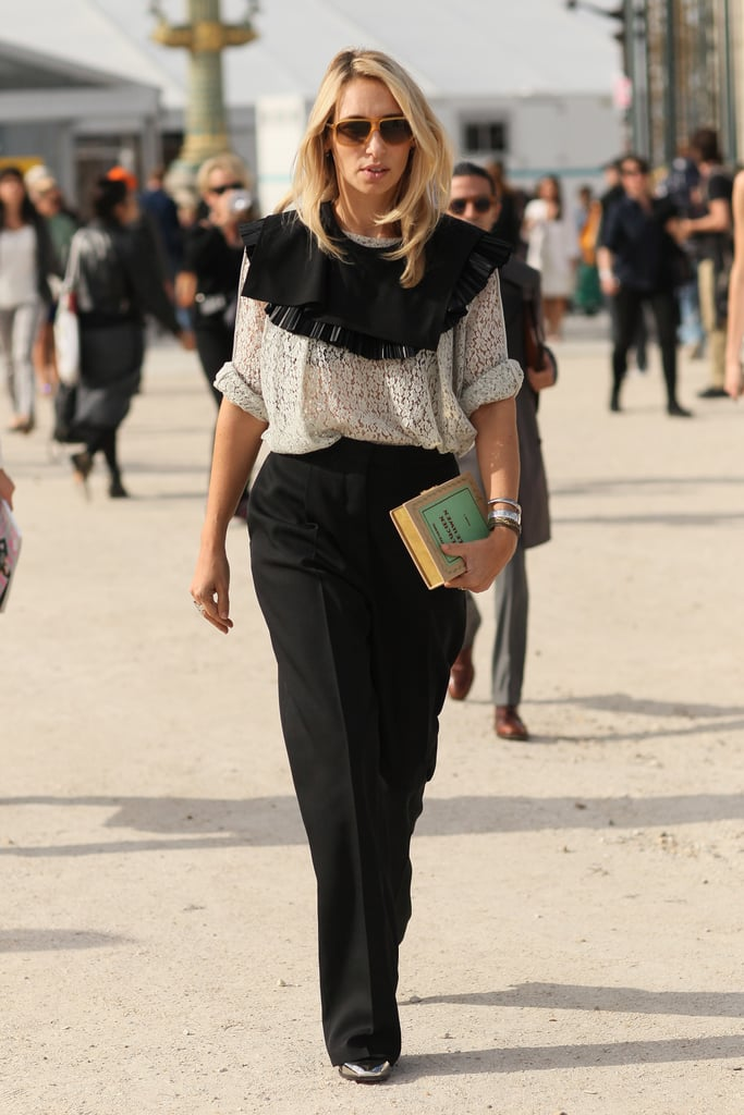 A playful collar gave new life to a lacy blouse and black pants — we're also obsessed with her literary clutch.
