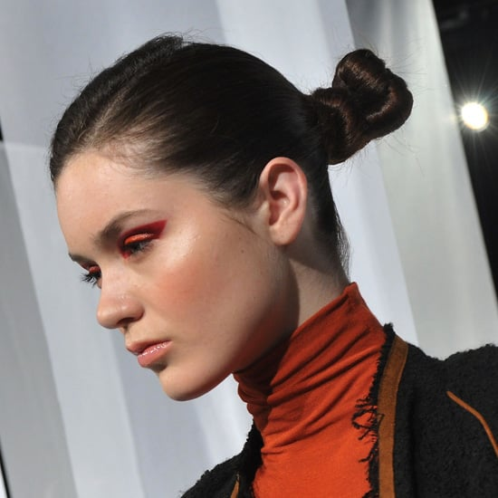 If you're attending a wedding that will be very formal and modern, wearing a hairstyle to match your surroundings is never a bad idea. This equestrian-inspired style from the Yoana Baraschi show is fashion forward, sleek, and easy to maintain.