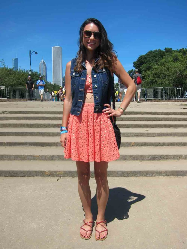 Don't let the light coral hue or the prep-friendly eyelets deceive you: this skirt is secretly a bare midriff in good-girl's clothing. Still, Jackie kept her Urban Outfitters skirt-and-bandeau-top set demure by layering a dark-wash Levi's vest on top.
