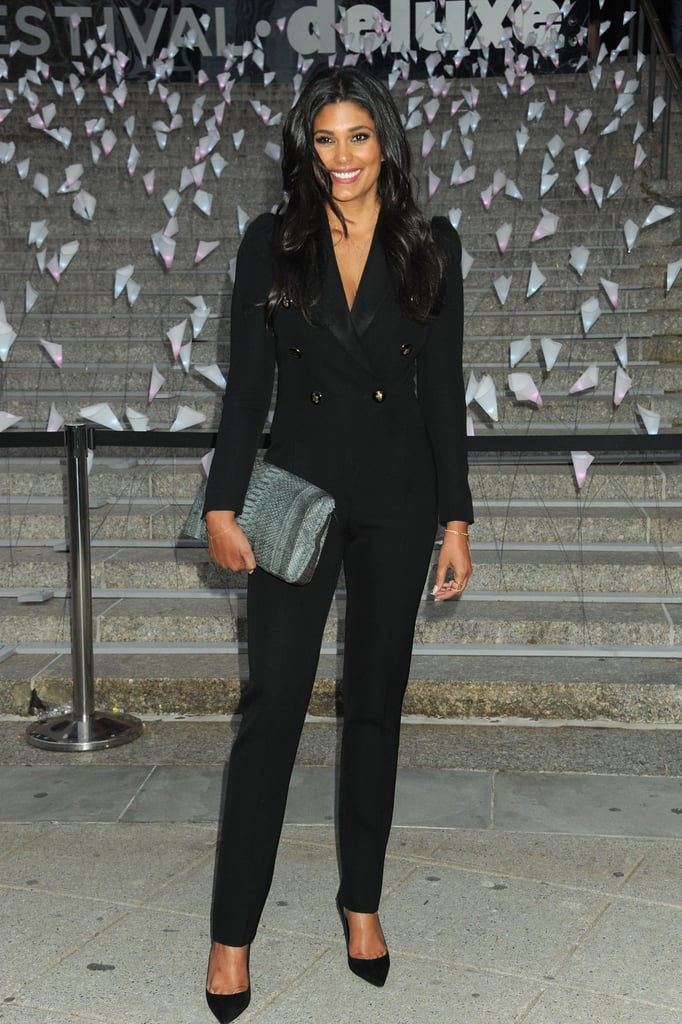 Rachel Roy — just like Karolina Kurkova — opted to go the menswear route with this double-breasted blazer and trouser combo. To finish, the designer added a blue reptilian-print clutch into the mix.