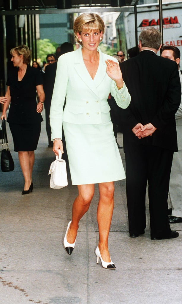 A matching suit set was Princess Diana's go-to. You can easily translate the look in a pretty jacquard style with a pair of pearl studs and two-tone court-shoe heels. Source: Getty/Anwar Hussein
