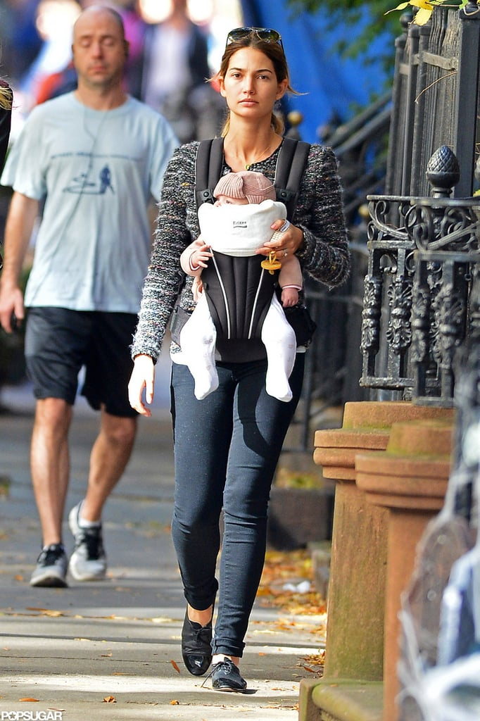 Lily Aldridge made her way down the street with Dixie.