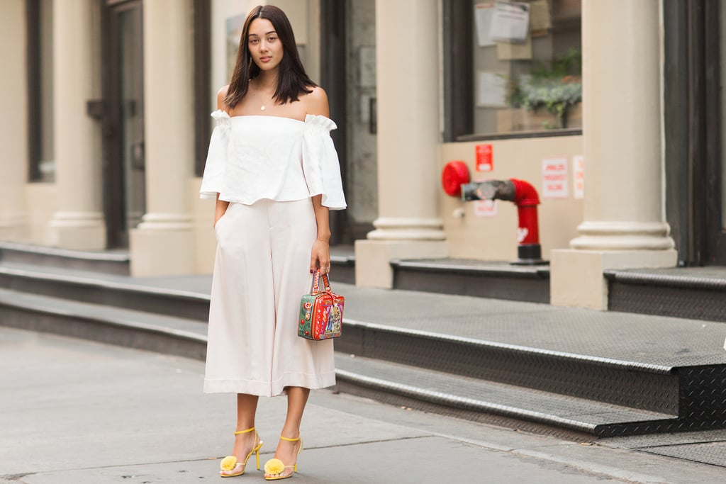 If you're daring to pair white on white, mix up the look by adding on eye-catching colorful accessories.