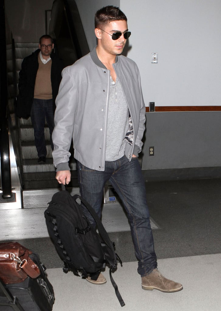 Zac Efron Looks Hot in Aviators as He Lands at LAX