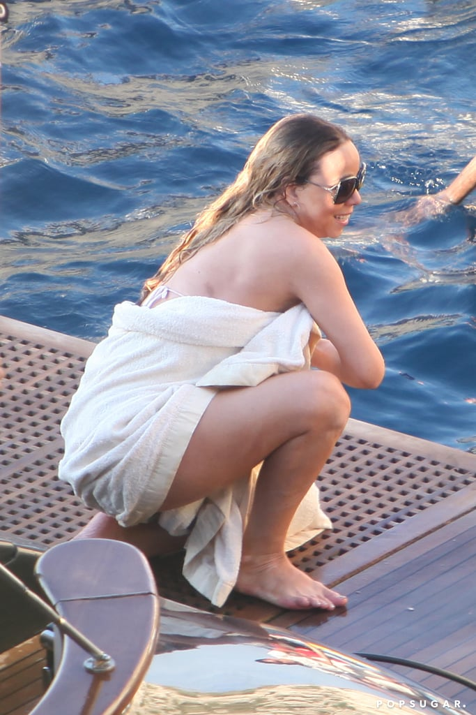 Mariah Carey covered up in the Blue Grotto.