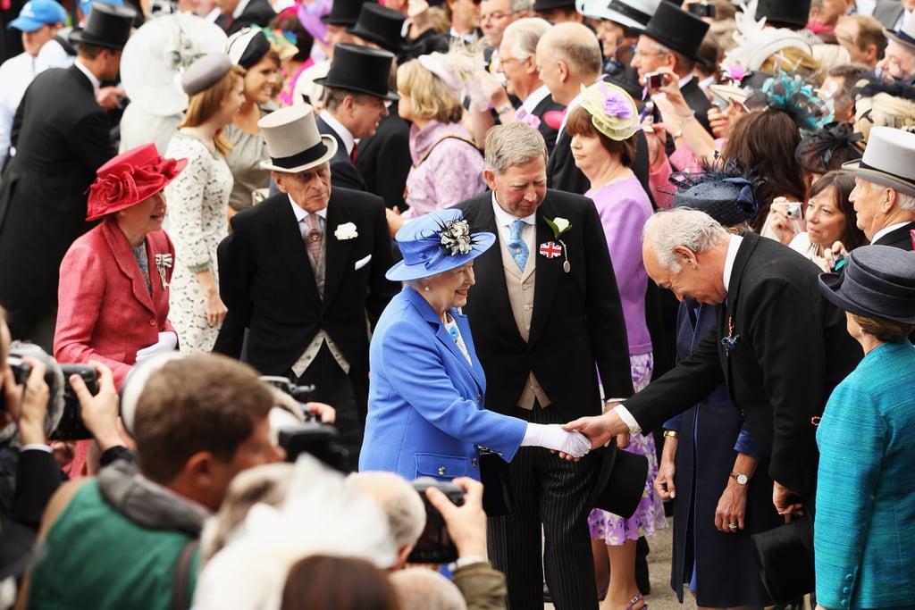 The queen greeted a racegoer.