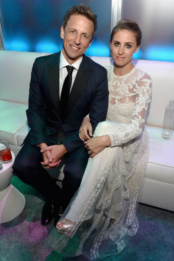 Seth Meyers and Alexi Ashe sat on a white couch.