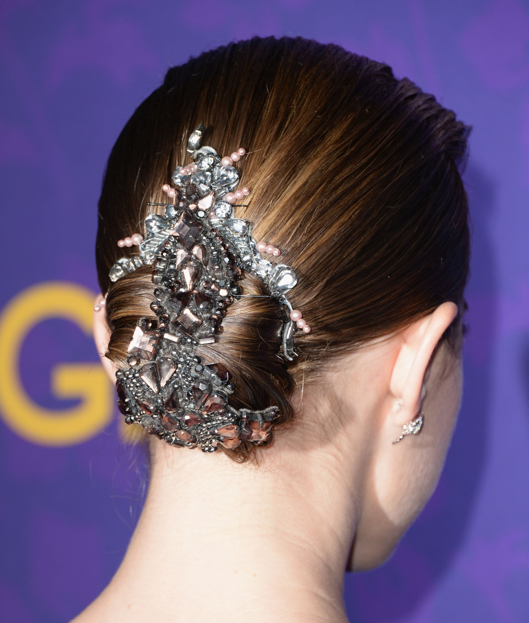The real centerpiece of Allison's style of the night, however, was her hair. Slicked back into a low bun, her strands were adorned with an elaborate hair accessory with sparkling crystals and pink pearls.