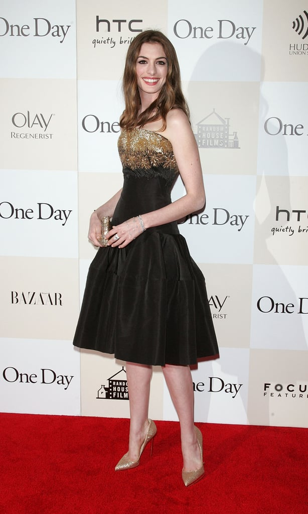 Wearing Alexander McQueen for the NYC premiere of One Day in 2011, Anne is sporting a signature look: tea-length cocktail dress, feminine embellishment, and ladylike elegance.