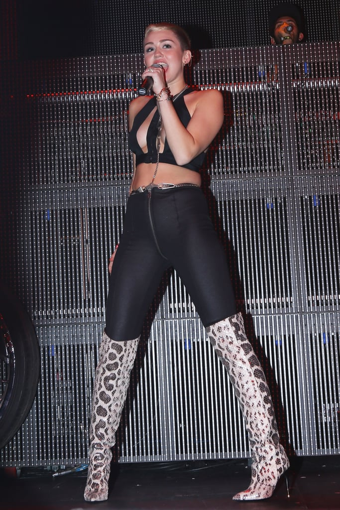 Cyrus closed out 2012 with statement-making python over-the-knee boots by Tom Ford.