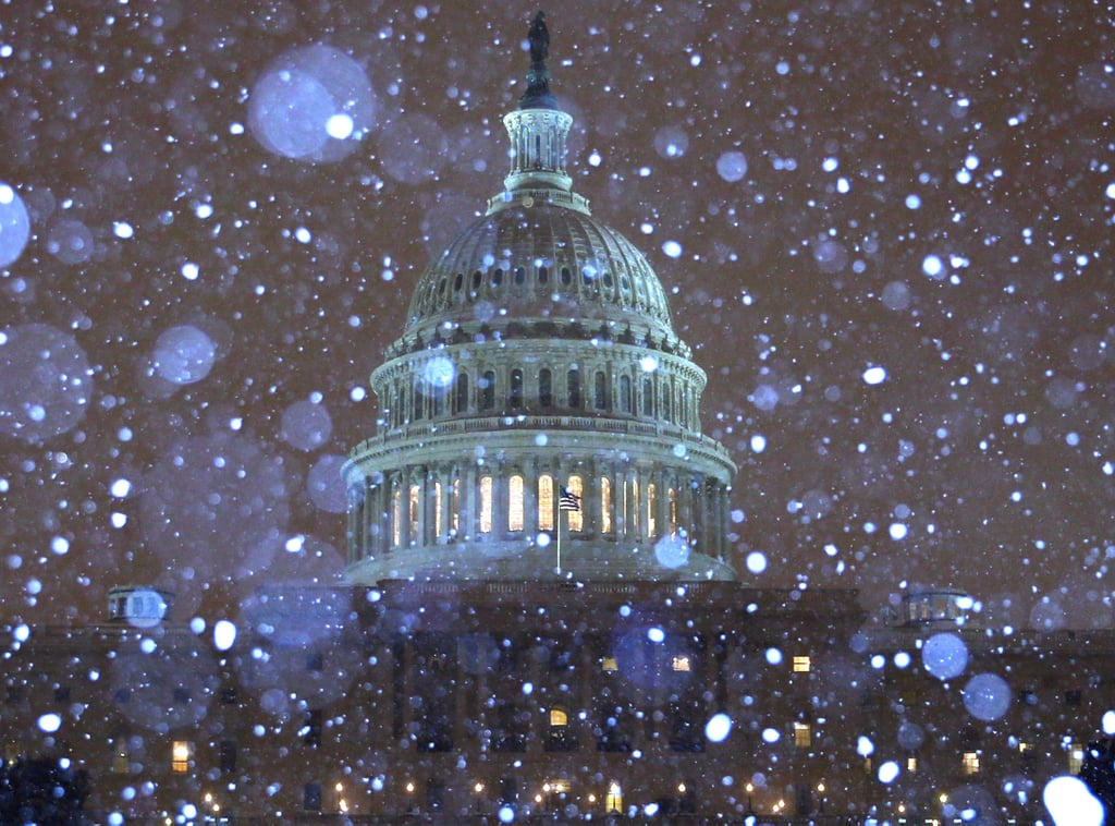 Snow fell over the US Capitol building in Washington DC.