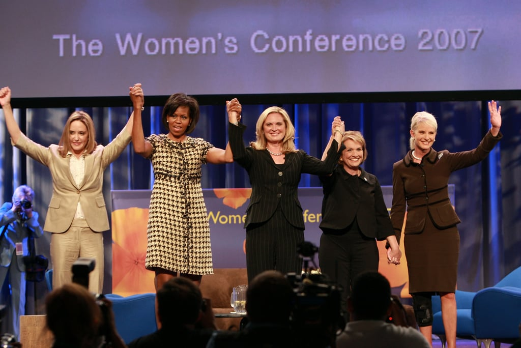 Michelle wore a retro houndstooth-printed cowl-neck dress to The Women's Conference in Long Beach, CA, in 2007.