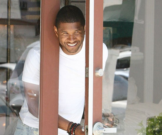Photo Slide of Usher Checking on His Ferrari in LA