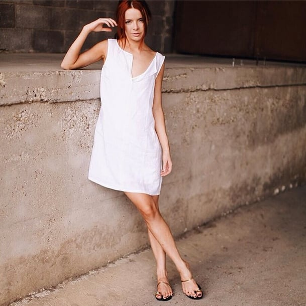 Don't underestimate the sexiness of a loose, white Summer dress paired with your go-to sandals. Source: Instagram user seaofshoes