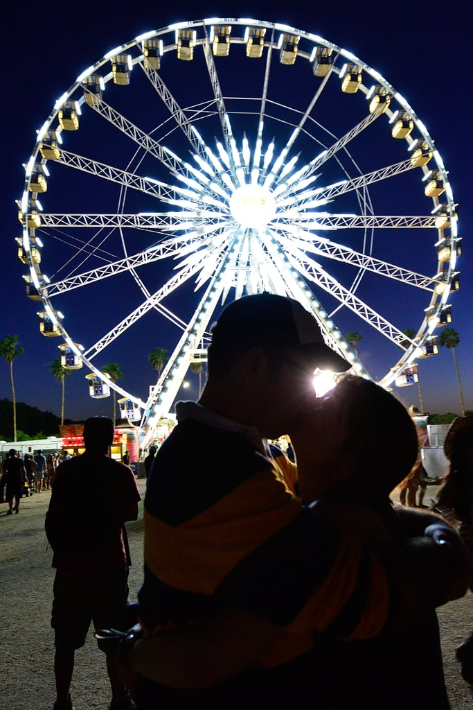 A couple got kissy in front of the ferris wheel at Stagecoach.