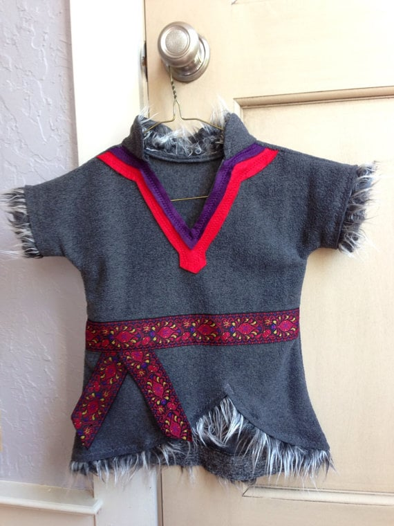If your tyke wants to be comfortable during his trick-or-treat expedition, this Kristoff tunic ($55) goes perfectly with a pair of cozy gray pants.