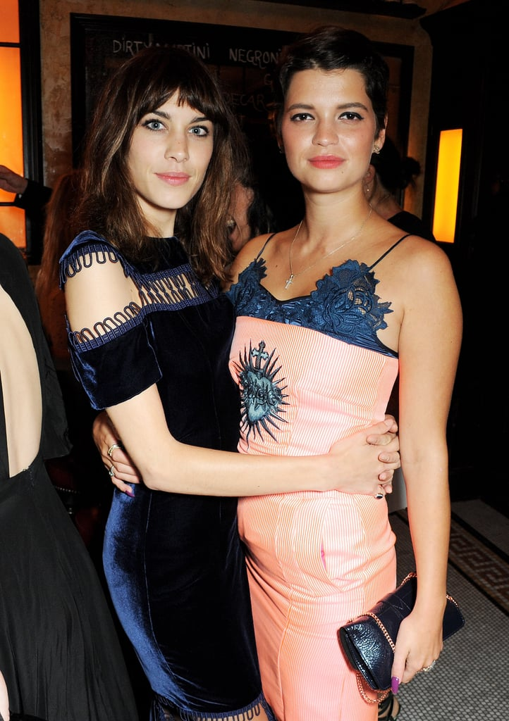 Alexa Chung and Pixie Geldof complemented each other's navy-detailed cocktail dresses at the British Vogue dinner.