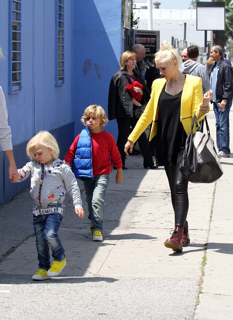 Gwen Stefani walked with her sons to an ice-skating rink in LA wearing a yellow blazer from Zara.