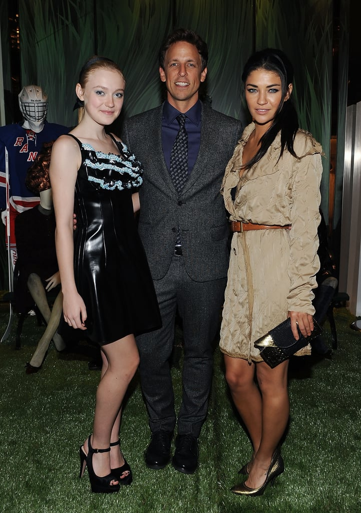 Seth Meyers was flanked by Dakota Fanning and Gossip Girl's Jessica Szohr at the Prada party in 2010.