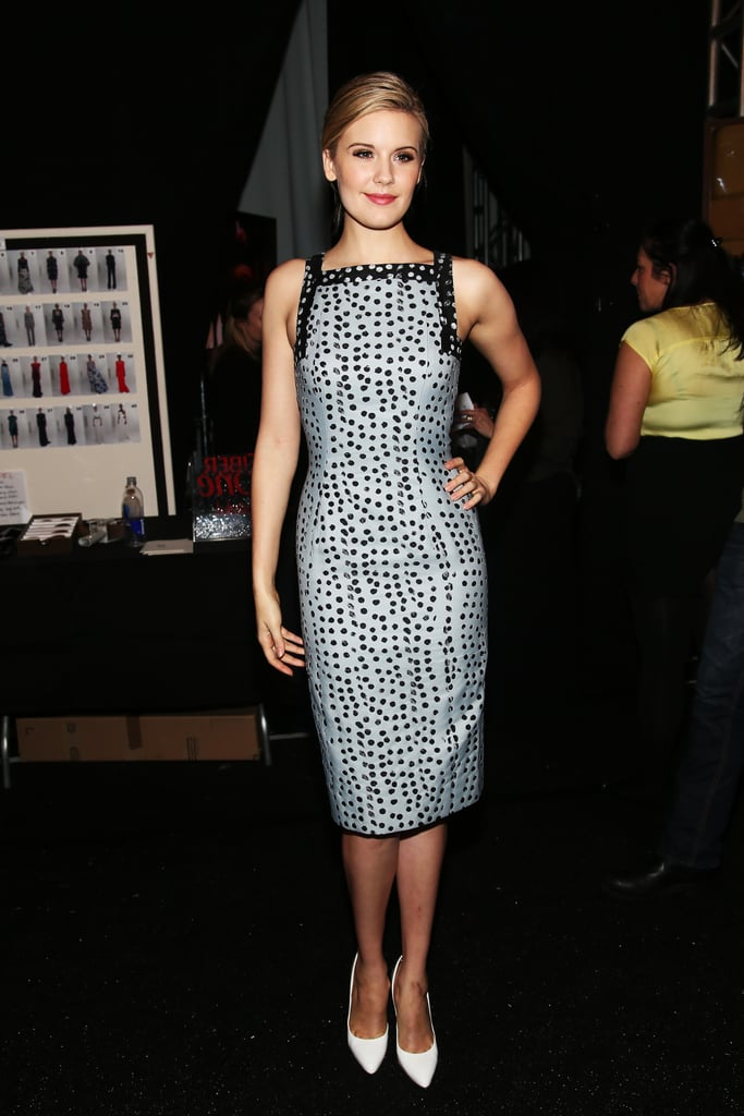 Maggie Grace was a lady fit for Carolina Herrera's Fall 2013 front row in a square-neck printed sheath dress and white pumps.