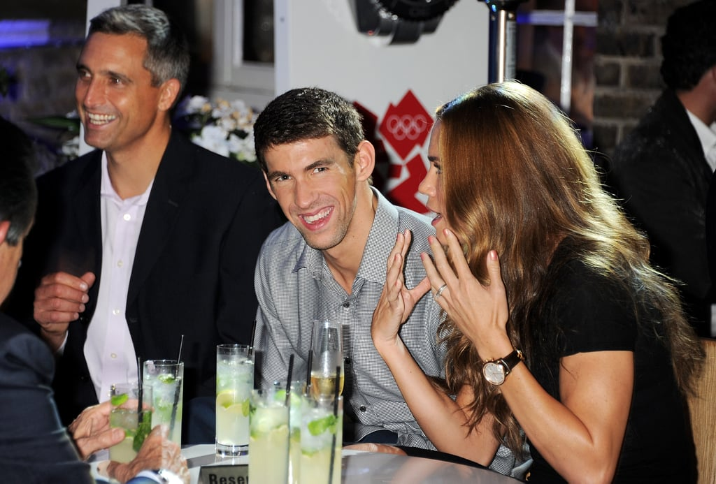Natalie Coughlin had Michael Phelps laughing at a swimming party in London.