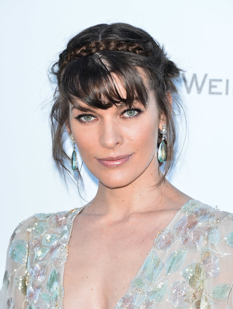 Milla Jovovich's crown braid is messy and boho.