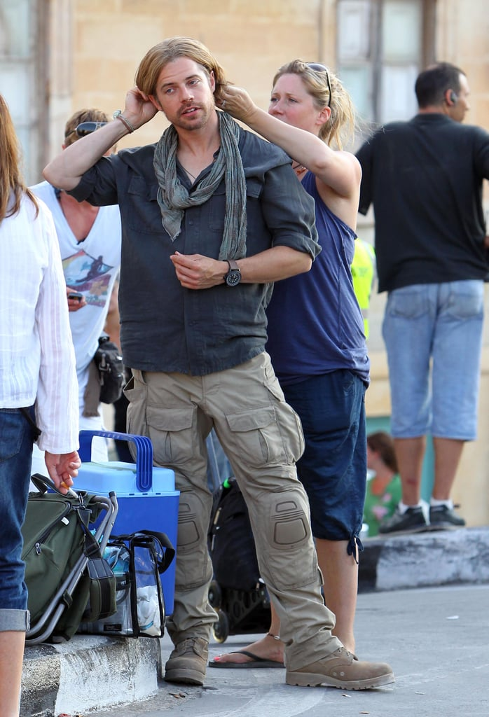 Brad Pitt's stunt double had his hair touched up by a stylist on the set of World War Z.