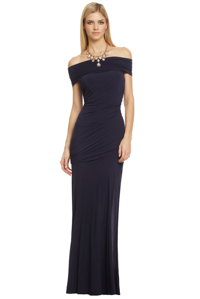 We love the subtly sexy off-the-shoulder neckline on this Donna Karan Prestige gown, originally $2,995 — but yours to rent for just $400.