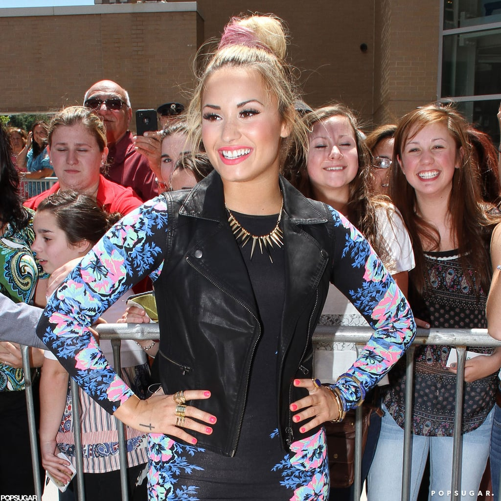 Demi Lovato wore a printed dress and leather vest.