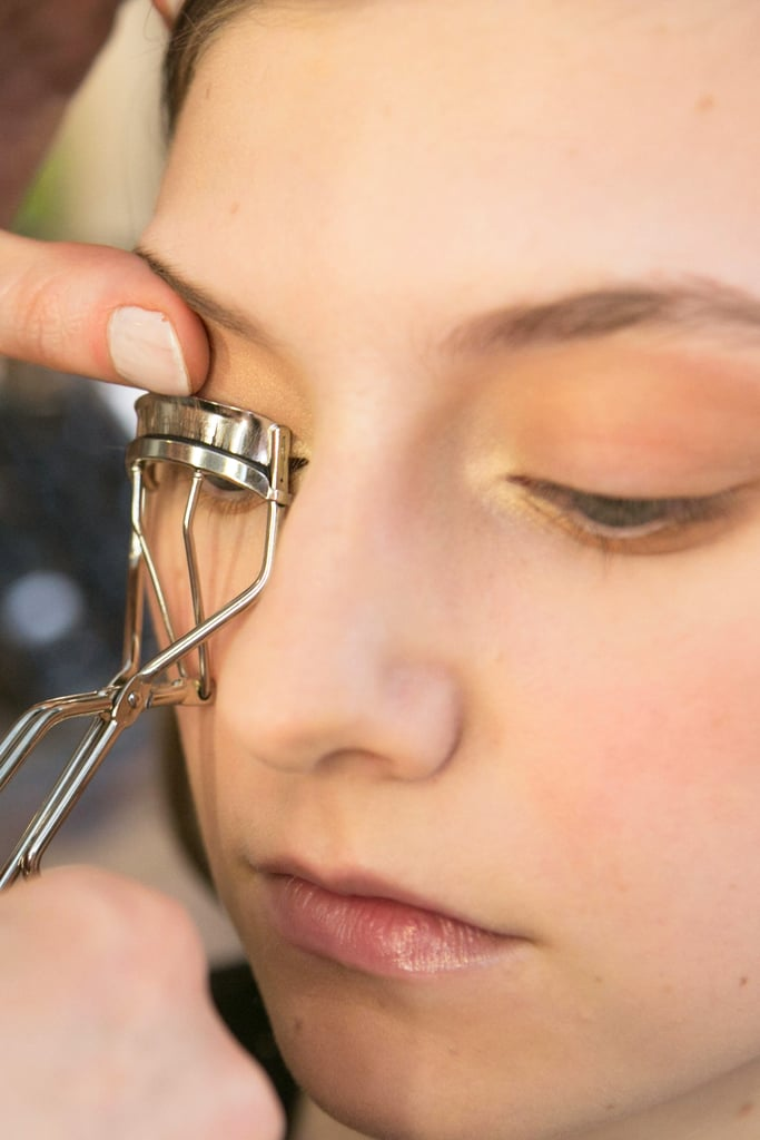 To make the neutral eye makeup pop, Bettelli went back and curled the eyelashes.