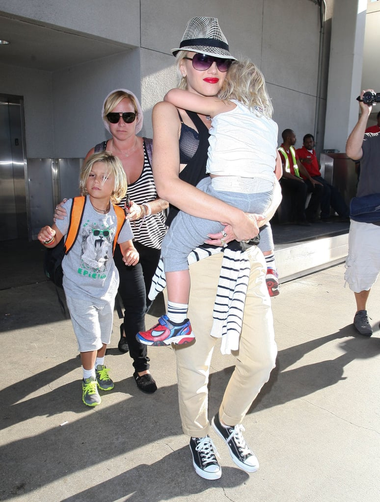 Gwen Stefani and her boys, Kingston and Zuma, landed at LAX.