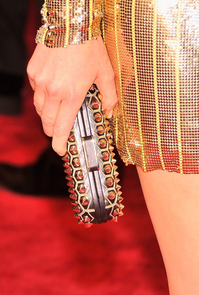 Elizabeth Banks carried a Brian Atwood studded clutch.