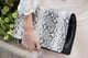 Rosie Huntington-Whiteley carried a black-and-white snakeskin clutch.