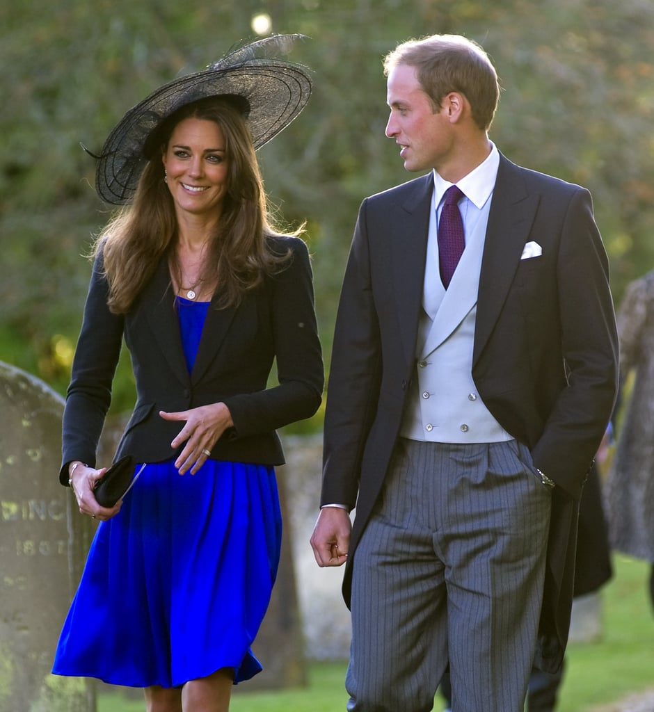 Kate Middleton wore a wide-brimmed black hat to a wedding in October 2010.