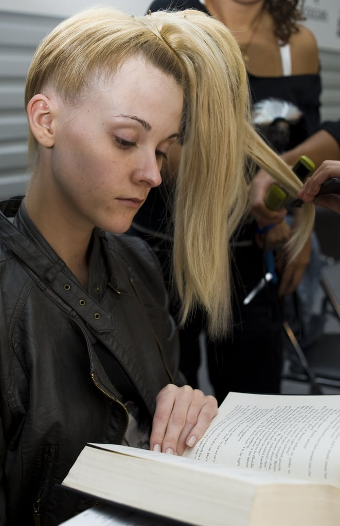 While getting her hair done backstage at the Mercedes Benz Fashion Week in Mexico City in 2010, a model flipped through a hefty book.